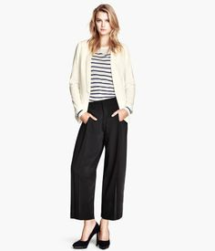 Wide trousers in woven fabric with a slight lustre, with creases at the front, a hook-and-eye fastener, concealed side pockets and a welt pocket at the back.