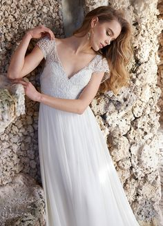Ivory Silk Georgette A-line bridal gown, beaded laser cut bodice, V- neckline with short cap sleeve,  natural waist, soft gathered skirt, chapel train. Bridal Gowns, Wedding Dresses by Jim Hjelm Bridal - JLM Couture - Bridal Style jh8508 by JLM Couture, Inc.