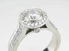 side view of custom halo ring with peek-a-boo diamond.  Center diamond is bezel set.