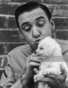 Headshot of American actor and singer Jim Nabors wearing a military uniform and cuddling a poodle, from his television series, 'Gomer Pyle, USMC'. Jim Nabors, Online Photo Gallery, Usmc, American Actors, Poodle, Cuddling, Actors & Actresses, Behind The Scenes, Photo Galleries