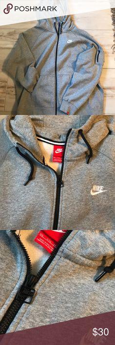 Nike full zip hoodie Grey fleece lined, Nike full zip hoodie. Left arm has zipper pocket detail and logo stitched to bottom of sleeve. Hood has jersey knit lining. Nike Shirts Sweatshirts & Hoodies