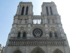 Paris, France - Notre-Dame the church was begun in 1163, the towers were added in 1245, finished in 1345. The center rose window dates back to 1220, 33 feet in diameter.  28 statues of the kings of Isreal & Judea under the rose window.