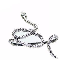 Crystal Snake Hand Goth Bracelet – Skullflow    https://www.skullflow.com/collections/skull-bracelets/products/crystal-snake-hand-goth-bracelet