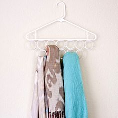 Make an inexpensive Scarf Holder from a Dollar Store hanger with shower rings taped to it.