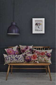 dark gray wall with pastel pillows