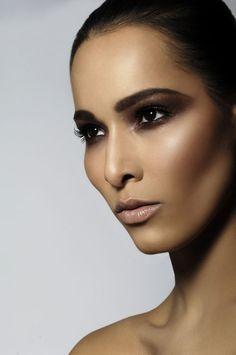 Dark brown smokey makeup...