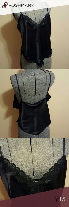 Vintage Intime Black Slip Camisole Vintage Tender Moments by Intime black lacy nylon slip camisole. Non-adjustable spaghetti straps with lace at bust and waistband. Fantastic condition without any noticeable flaws. Vintage Intimates & Sleepwear Chemises & Slips