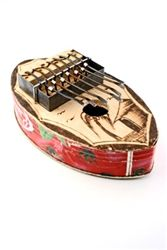 Recycled Tin Can Kalimba (thumb piano) from Burkina Faso. Great gift idea for music lovers. http://www.worldtravelart.com/Large_Oval_Recycled_Tin_Can_Kalimba_Thumb_Piano_p/bk-09e.htm