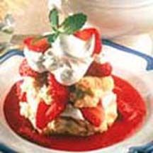 Strawberry Shortcake with Fresh Sauce - Fluffy shortcake biscuits, split open and steaming, loaded with sliced strawberries, languishing in a sweet pool of fresh strawberry sauce and topped with dollops of whipped cream.