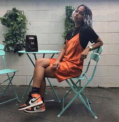 orange silk slip layered over a black t-shirt paired with black and orange sneakers. Visit Daily Dress Me at dailydressm Trendy Outfits, Summer Outfits, Cute Outfits, Fashion Outfits, Womens Fashion, Fashion 2018, Urban Fashion Women, Hijab Fashion, Fashion Online