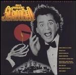 "The soundtrack to Scrooged features updates on Christmas classics as well as original material by Dan Hartman and Denise Love, Mark Lennon, Robbie Robertson, and Buster Poindexter. The album's sound, as well as its roster of artists, give it the feel of a time capsule buried in the late '80s, for better or worse. While Natalie Cole's ""The Christmas Song (Chestnuts Roasting on an Open Fire)"" fares the best, most of the album, including Annie Lennox and Al Green's ""Put a Little Love in Your…"