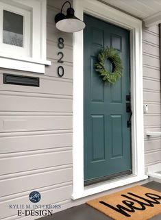 7 Best Teal and Navy Blue Front Door Colours : Benjamin and Sherwin. Shown on this exterior with gray painted siding, Sherwin Williams Still Water, a dark blue green gray blend color. Trim is Pure White. Kylie M EDESIGN Teal Front Doors, Teal Door, Front Door Paint Colors, Painted Front Doors, Paint For Front Door, Colored Front Doors, Dark Front Door, Outside House Paint Colors, Front Door Molding