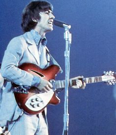 "George sings and plays lead guitar in ""If I needed someone"" Shea Stadium, 1966. Rickenbacker replaced his stolen '64 prototype 12-string with this production model, much like those used by Roger McGuinn of the Byrds and Carl Wilson of the Beach Boys"