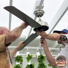 Oliver and Keil install one of two overhead fans in our Aquaponics USA Food Forever™ Farm Demo Greenhouse!  We also have 5 wall fans in this  15 x 40 sq. ft. Greenhouse. Our plants think they're outside!  Go to AquaponicsUSA.com to learn about Aquaponics.  #organicfoods