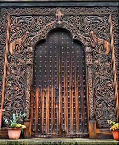 massive carved wood door and frame