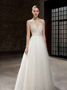 f2779c076574 Ethereal and Romantic Wedding Gown with Lace over Nude Underlay