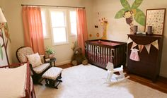 Like the curtains give a girly feel, like the chair pattern, & the fabric banner! Girly jungle nursery!