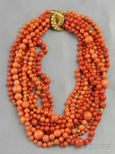 Multi-strand 18kt Gold and Coral Bead Necklace, Verdura - composed of nine strands of coral beads ranging in size from approx. 4.20 to 12.30 mm, spaced by gold bead accents, completed by an 18kt gold ribbed clasp, lg. 16 1/2 in., signed.