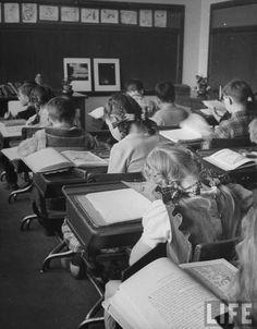 Working hard in class. Ohio, 1946. By Frank Scherschel