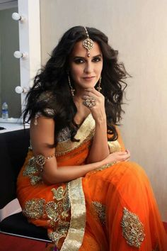 Bollywood Actress Neha Dhupia Latest Photoshoot in Orange Color Saree Golden Border Saree