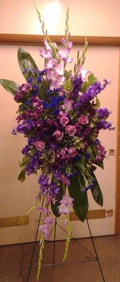 Black Baccara Designs is a Full Service Florist. We offer custom wedding and event designs. Complete funeral and sympathy tributes. Custom home decor and special ocassion flowers. Funeral Sprays, Corsage And Boutonniere, Spray Roses, Easel, Event Design, Custom Homes, Floral Design, Purple, Flowers