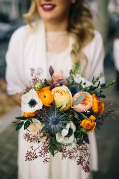 I'd really like arrangements like this one - the bright orange, the thistle, the hints of purple, for the wedding day (30 September).