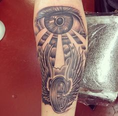 Motorcycle wheel with wings tattoo