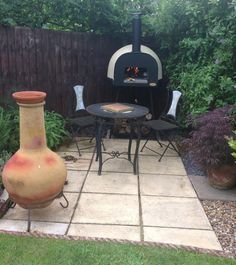 The lovely #dome60 nestled beautifully in the corner of the garden. #outdoorcooking #woodfired