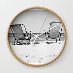 "Available in natural wood, black or white frames, our 10"" diameter unique Wall Clocks feature a high-impact plexiglass crystal face and a backside hook for easy hanging. Choose black or white hands to match your wall clock frame and art design choice. Clock sits 1.75"" deep and requires 1 AA battery (not included)."