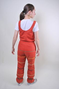 Ellesse orange suspenders ski suit, woman snow jumpsuit, Size M Welcome to TARASCOMMON.COM Unique clothing from the century. Model tall - Size: M. Snow Pants, Ellesse, Snow Suit, Unique Outfits, Orange, Suspenders, Suits For Women, Skiing, Vintage Ladies