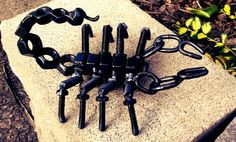 Scorpion figure made from nuts, bolts, screws and chain, painted hammered black. 8x6x4. I have the ability to create anything from metal to fit you