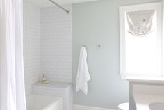 White subway tile with gray grout and marble hexagon floors || Studio McGee
