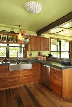wood floors, wood cabinets, concrete countertop