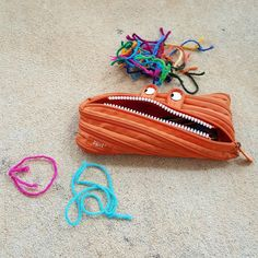 crochetbug, crochet took kit, yarn scraps, scissors, crochet hooks