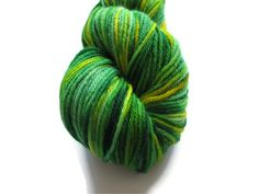 This is a lovely skein of hand dyed worsted weight yarn in a lovely combination of greens and yellows. This 100% wool yarn is plush and soft, perfect for baby wear, hats, mittens, scarves, or whatever your next project may be.    This yarn is dyed in a multi-step method which involves applying layers of color in a manner that should prevent excessive pooling or flashing as their is no repeated pattern to allow the colors to do so.     This skein is approximately 250 yards and 4.5 ounces.