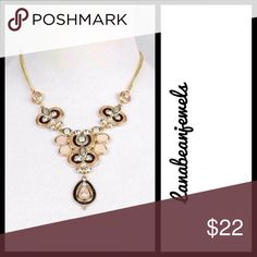 A gorgeous gold necklace! A gold necklace with pink stones. Highlighted with black and clear details Jewelry Necklaces