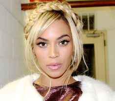 Queen Bey's flawless makeup and braid crown