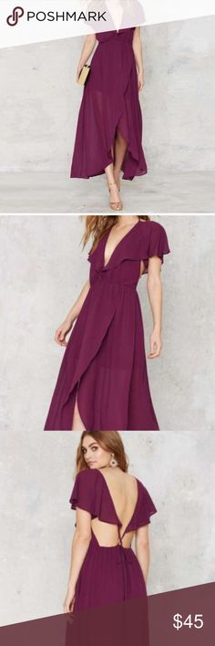 Nasty Gal Plunging Purple Dress Beautiful plum colored dress with an adjustable neckline and flowing sleeve accents. Lined to look like a mini dress with a flowing back train and slit in the sheer overlay. Open back that's fully adjustable. Worn once. Nasty Gal Dresses High Low