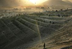 You watched Kite-Runner? Afghan men and boys gather on a Kabul hillside for a kite flying competition at dusk on Friday, March 10, 2006