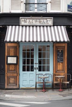 Paris Cafe Fine Art Photograph Malabar A charming Parisian cafe with classic details including a striped awning, chalkboard menu, blue doors and Design Café, Cafe Design, Design Trends, Design Ideas, Cafeteria Paris, Rustic Table And Chairs, Cafe Exterior, Exterior Design, Exterior Colors