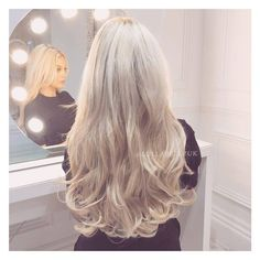 Our new and improved 'Double Thick Layered' hair extensions gives you the thickness of our 8 piece but with the convenience of our 1 weft! They have been pre-styled so all you have to do is clip them in and you're ready! You can apply the wefts individually meaning you could wear the shorter layer (16inches) for the daytime and longer set (20 inches) for date night, double them up for wow-factor and its party time! Model is wearing our 'Double Thick Layered Curly' in the shade Champa...