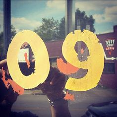 #09 #numbers #windows #reflections #gold #clouds #pizza #reverse #weathered #aged #sign