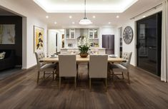 """Need some laminate flooring ideas? Our Gladiator 7.5"""" Water Resistant Laminate in Attilus is the ideal water-resistant laminate for living rooms. Not only is this wood-look laminate water-resistant but it also has an amazing genuine wood grain texture. It retails starting at $2.99 SQ FT."""