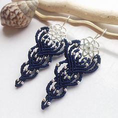 Dark blue flower macrame earrings with sterling silver. The size is 3,5 inch with earwire. Materials: dark blue nylon macrame cord 0,8 mm, Sterling silver beads 2 mm, sterling silver connector with earwire flower of life. my own design and work elegant earrings is good choice for