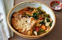 Even vegetable stews can have more vegetables. This recipe adds a pound of kale -- that's right, a full pound -- to softened onions, carrots and celery, combined with beans and tomatoes It's simply a matter of bringing the other vegetables together in a simmer, then adding the kale and topping with the toast