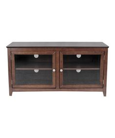 Elegant and simple, this TV stand is packed with tons of features to create a customized entertainment hub. Featuring adjustable shelves, wire management access holes and ample space for up to four electronic pieces, it's functional and stylish.