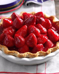 Next time you get a pint or two of perfectly ripe strawberries, make this favorite pie. It combines fresh berries and a lemony cream cheese layer. If you're in a hurry, use a premade pie shell. | Best Ever Fresh Strawberry Pie Recipe from Taste of Home