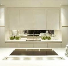 Want a mirror splashback like in this kitchen in the laundry also to make it look brighter and bigger
