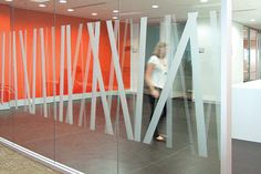 Corporate bank offices in Australia, designed by There Design. Custom glazing graphics, meeting room identification, lift lobby graphics and a subtlety changing vibrant paint scheme were created throughout.