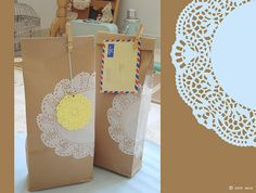 Brown paper bags tied up with doilies!